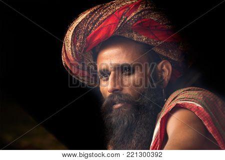 BABUGHAT, KOLKATA, WEST BENGAL / INDIA - 11TH JANUARY 2015 : Indian Hindu Sadhu loking out from his Gangasagar transit camp.