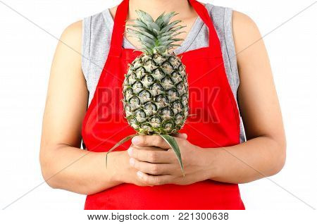 Green pineapple fruit holding by chef's hand isolated on white background
