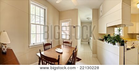 wide panorama of dated interior diningroom and kitchen