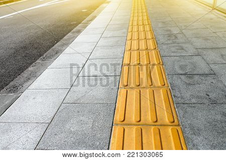 tactile paving for blind handicap on tiles pathway, walkway for blindness people.