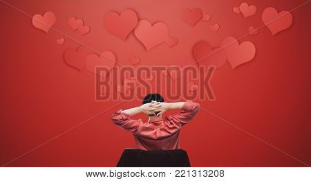 a man falling in love. Asian guy stretching arm with floating hearts. Valentines day concept