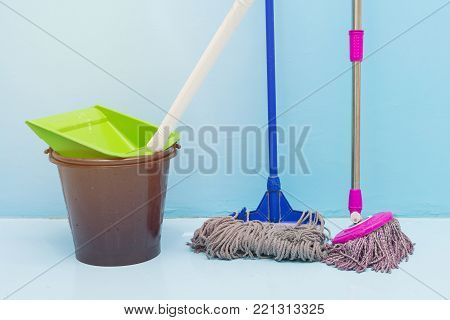 Cleaning Floor With Wet Mop And Dustpan In Room