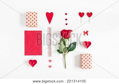 Valentine's Day. Rose flower, gifts, candles, confetti on white background. Valentines day background. Flat lay, top view