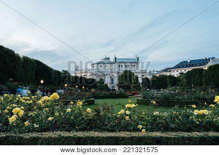 Vienna,  Austria - August 17, 2017:  Burgtheater at sunset, view from Volksgarten. The Burgtheater is the Austrian National Theatre in Vienna.