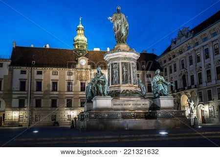 Vienna,  Austria - August 17, 2017: Kaiser Franz I monument in the courtyard of Hofburg Palace at night.