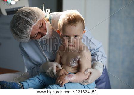 Belarus, the city of Gomel.City burn hospital.June 02, 2017.To a little boy, a nurse heals a burn.Kid in the hospital wounded.The doctor heals a little bit.The boy was burned.Little hospital patient