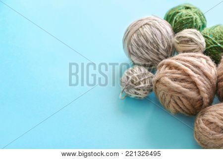 Set of woolen clews on color background