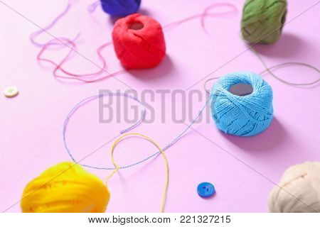 Set of crocheting clews on color background