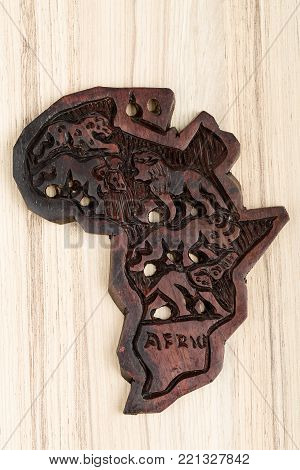 wooden map of continent africa with animals, big five