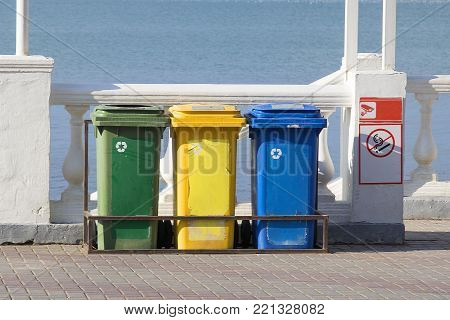 Trash Containers for Garbage Separation -- three colors for plastic, metal and burnables