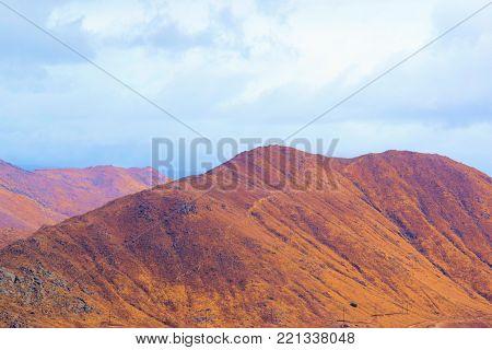 Barren hills with dry golden hills taken in Riverside, CA