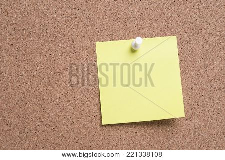 sticky note or post is on cork bulletin billboard.