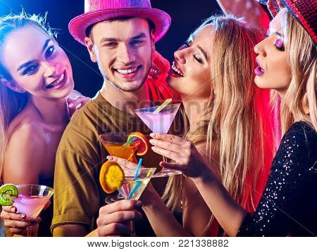 Dance party with group people dancing. How to be an alpha male at a club. Women and confident casual smiling man have fun in night club. Rest after hard day at work.