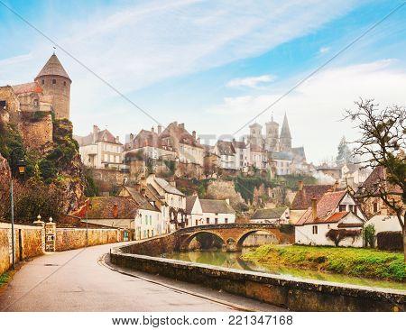 River embankment Armancon, Semur-en-Auxois, Burgundy, France. Toned image