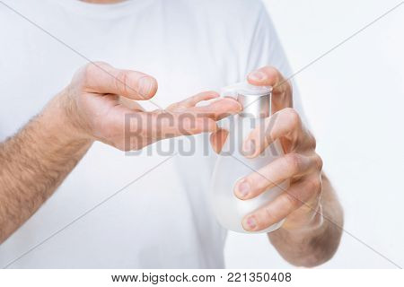 Antibacterial effect. Close up of antibacterial soap being used by a nice pleasant man while washing his hands
