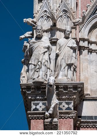 Close-up of the exterior of the Duomo of Siena, featuring prophets, philosophers, apostles and various animals.