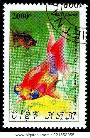 Ukraine - circa 2018: A postage stamp printed in Vietnam shows drawing fish Goldfish or Carassius auratus var. Series: Fish - Goldfish, Veil-tailed. Circa 1990.
