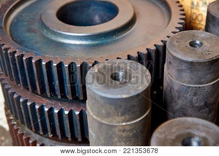Unworked gears and shafts in the shop at the factory