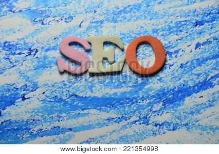 word seo on an  abstract colored backgrounbd