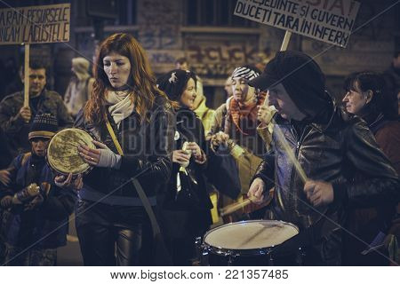 Bucharest, Romania - October 6, 2013: Protesters loudly play the drums during the population uprising against the cyanide open-cast gold extraction in Rosia Montana heritage site, Alba County.