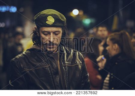 Bucharest, Romania - October 6, 2013: Concerned man joins the mass rally against the plan to open Europe's largest open-cast goldmine in Rosia Montana