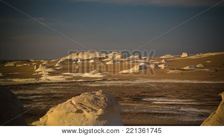 Night photography of the Abstract nature rock formations aka sculptures in White desert at Sahara, Egypt