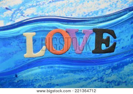 word love on an abstract coloredc background