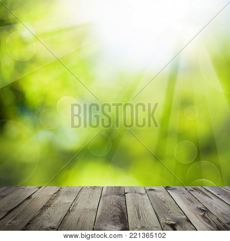 Abstract Green Background with Empty Wooden Table and Green Bokeh Sparkle