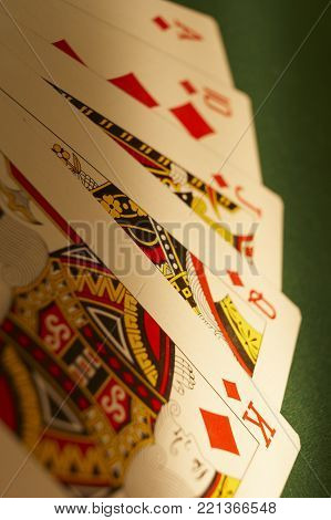 CLECKHEATON, WEST YORKSHIRE, UK: HAND OF PLAYING CARDS SHOWING ROYAL FLUSH ON GREEN CLOTH GAMING TABLE, CIRCA 2007, CLECKHEATON, WEST YORKSHIRE, UK