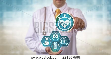 Unrecognizable male doctor of medicine showing a cardio app to remote patient. Healthcare concept for telemedicine, wearable technology, medical check-up via conference call and telepresence.