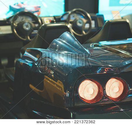 Blue racing simulator game in theme park.