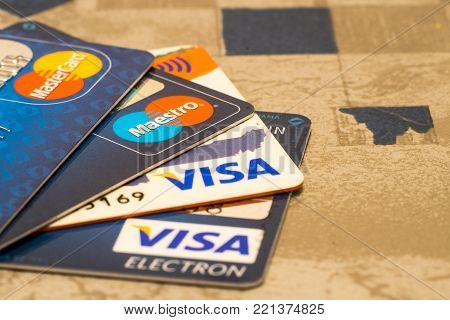 Sarajevo, Bosnia and Herzegovina - December 21, 2016: closeup pile of credit cards, Visa and MasterCard, credit, debit and electronic