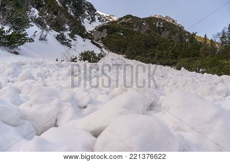 Snow lumps after descent of avalanche. High Tatras. Poland