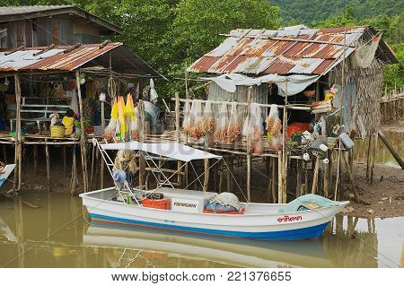 KOH CHANG, THAILAND - MAY 26, 2009: View to the fishermen's village with stilt residential houses and fishing boats in Koh Chang, Thailand.