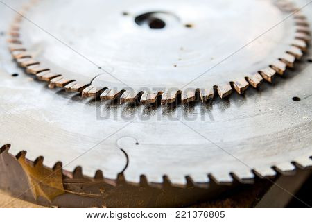 Close up image of metal circular saw attachment for woodworking