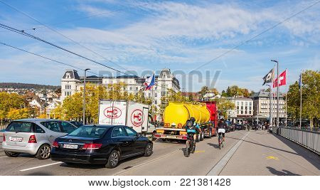 Zurich, Switzerland - 29 September, 2017: traffic on Quaibrucke bridge, buildings at Bellevue square in the background. Zurich is the largest city in Switzerland and the capital of the Swiss canton of Zurich.