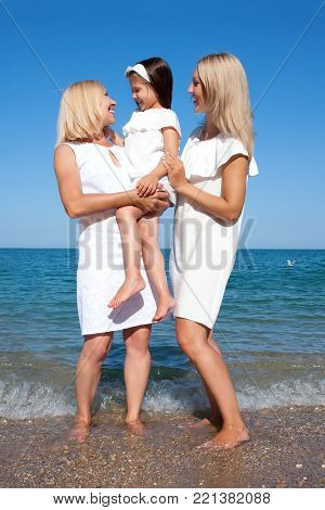 Three Generations Of Women On The Beach