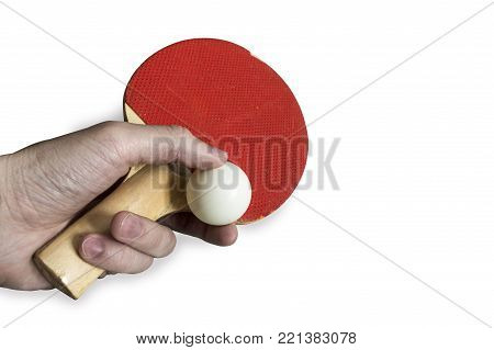 The hand holds a racket and a ping-pong ball