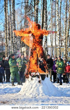 TULA, RUSSIA - MARCH 3, 2016: Traditional burning of Maslenitsa Scarecrow on seeing Russian winter on last day of Shrovetide