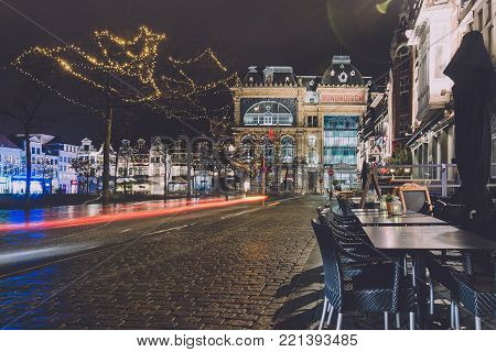 January, 3th, 2017 - Ghent, East Flanders, Belgium. Socialist guild Hall Bond Moyson and christmas illumination on Friday market in Gent during winter festival by night.