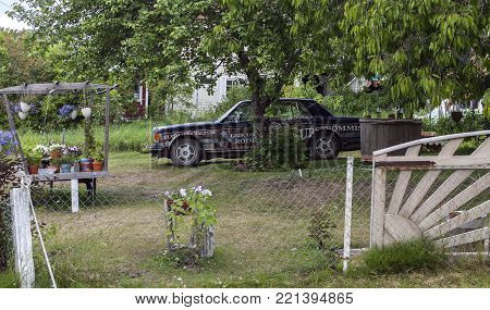ULVON, SWEDEN ON JULY 18. View of a special designed car in a garden on July 18, 2017 in Ulvon, Sweden. Swedish fermented Baltic herring. Editorial use.