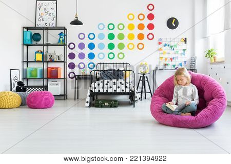Kid In Colorful Bedroom