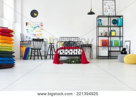 Kid's Room With Rainbow Pillows