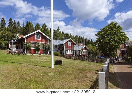 ULVON, SWEDEN ON JULY 18. View of colorful houses, cabins, lodges along the road in the village on July 18, 2017 in Sweden, Ulvon, High Coast Heritage. Editorial use.