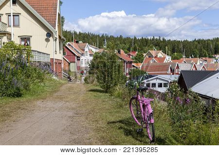 ULVON, SWEDEN ON JULY 18. View od a cycle, pathway and a village on July 18, 2017 in Ulvon, High Coast Heritage, Sweden. Bushes and flowers. Editorial use.