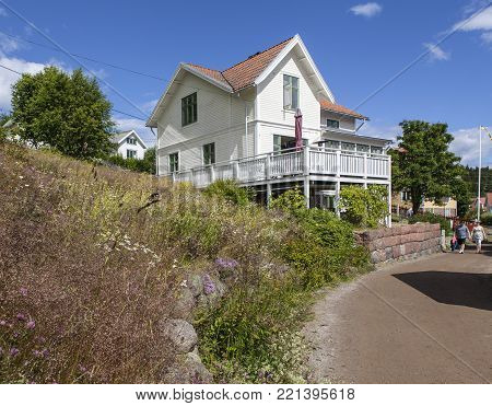 ULVON, SWEDEN ON JULY 18. View of a house, cabin, lodge along the road in the village on July 18, 2017 in Sweden, Ulvon, High Coast Heritage. Editorial use.
