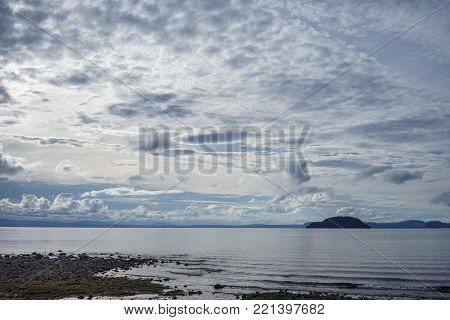 The lake with cloudscape at sunny day in North Island, New Zealand.