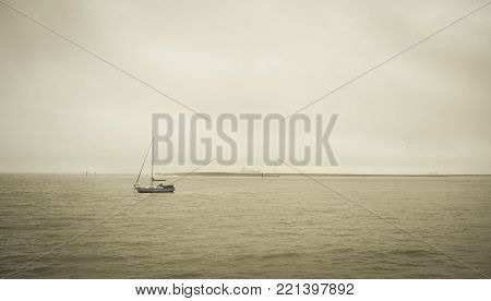A boat on sea at misty day in North Island, New Zealand.