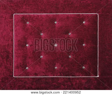 Close up background of purple burgundy color soft velvet bed headboard with rhinestone crystals, front view poster