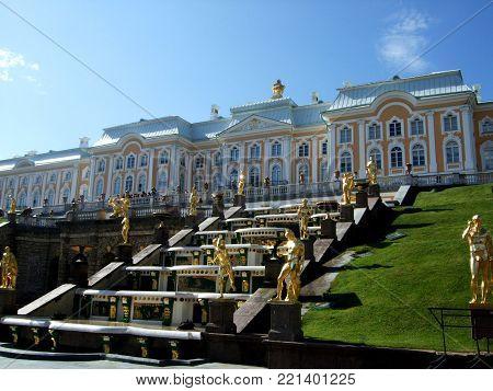 Petergof, Saint peterburg, Russia - JUNE 12, 2013: Opening of the Peterhof fountains. Gold statue